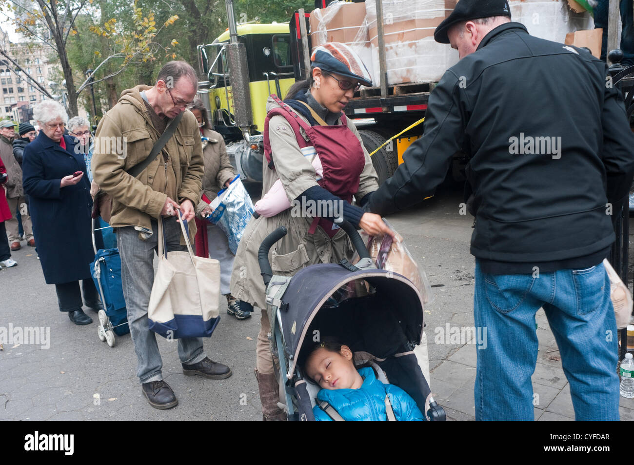New York, NY -  2 November 2012 Residents of Lower Manhattan, who have been left without power, heat, hot water, - Stock Image