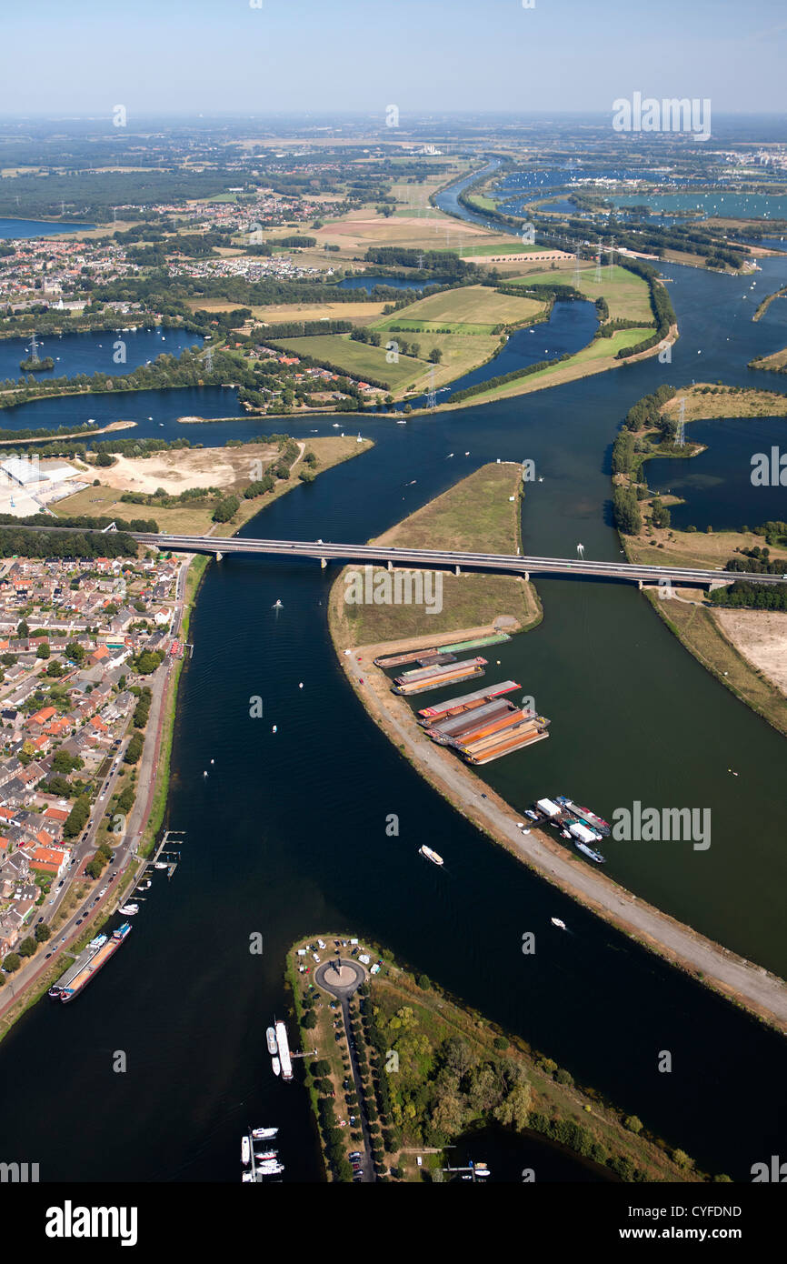 The Netherlands, Maasbracht, Highway A2 passing river Maas or Meuse. Aerial. Stock Photo