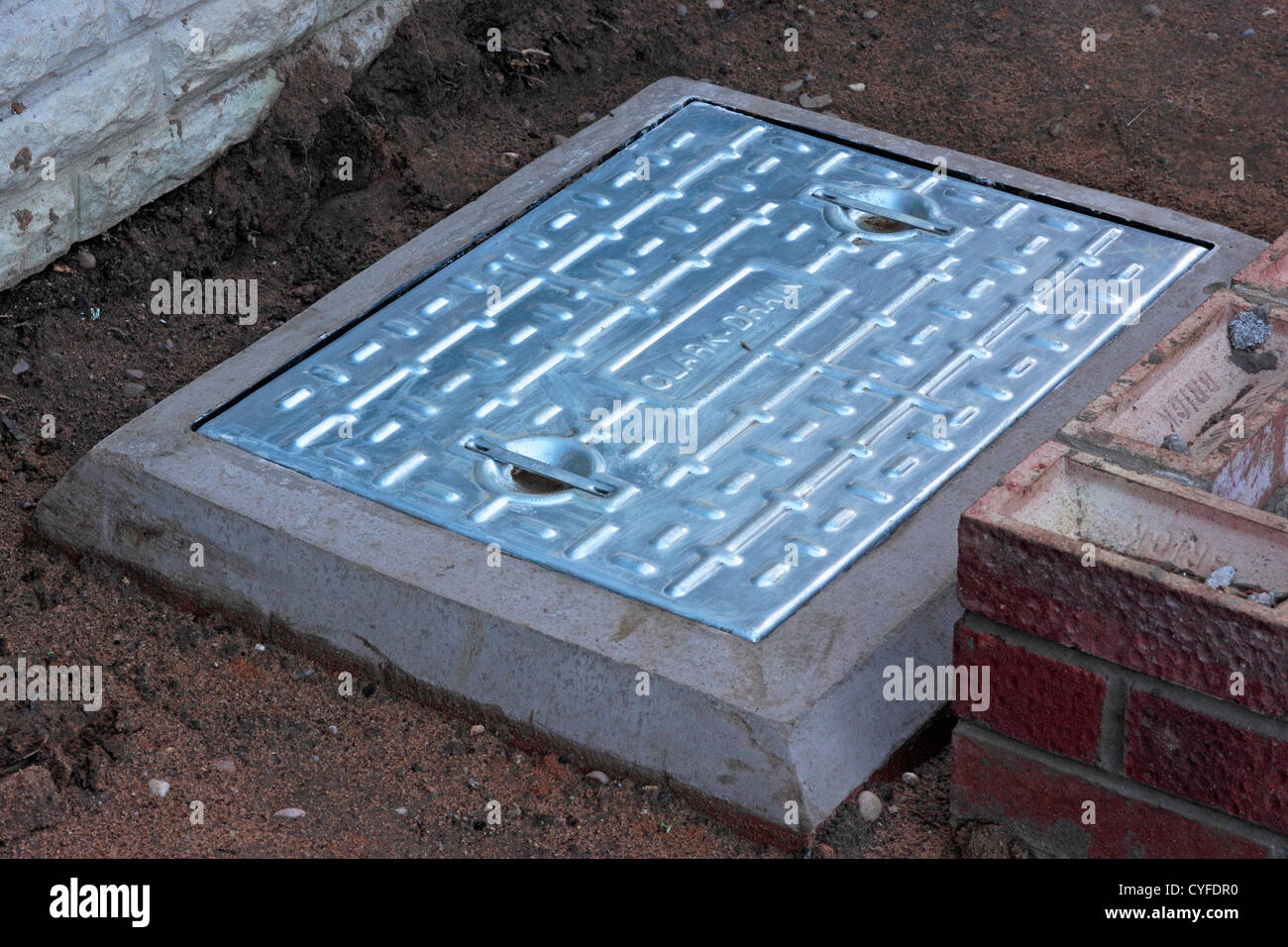 Newly Installed Domestic Drain Inspection Chamber Cover - Stock Image