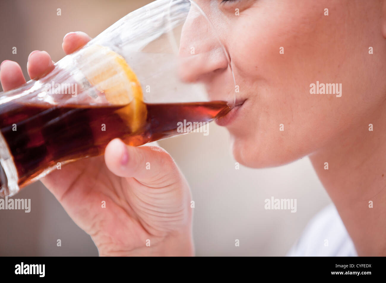 young woman is drinking lemonade outside in summer close up Stock Photo