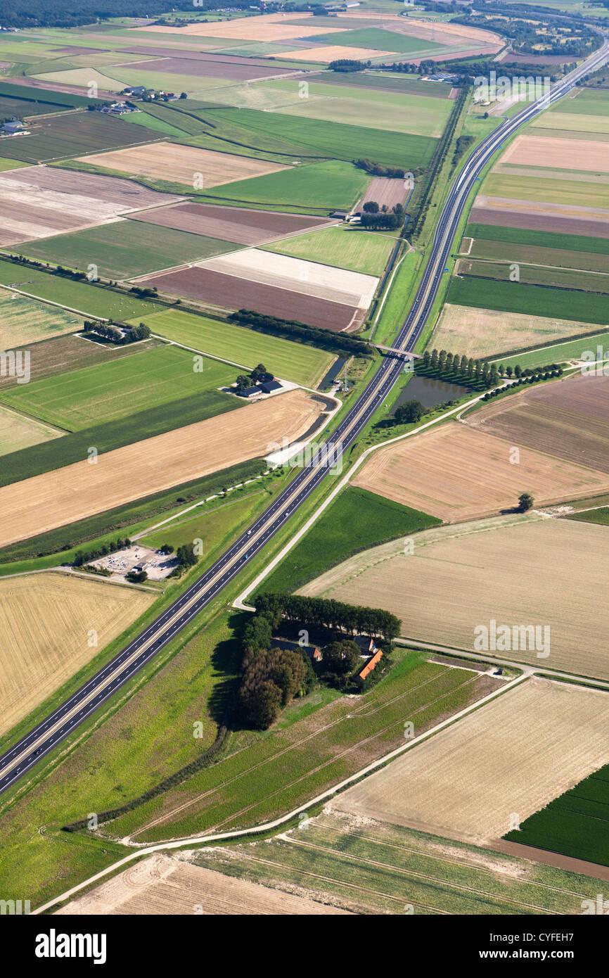The Netherlands, Hoogerheide, A4 highway and farmland. Aerial. - Stock Image