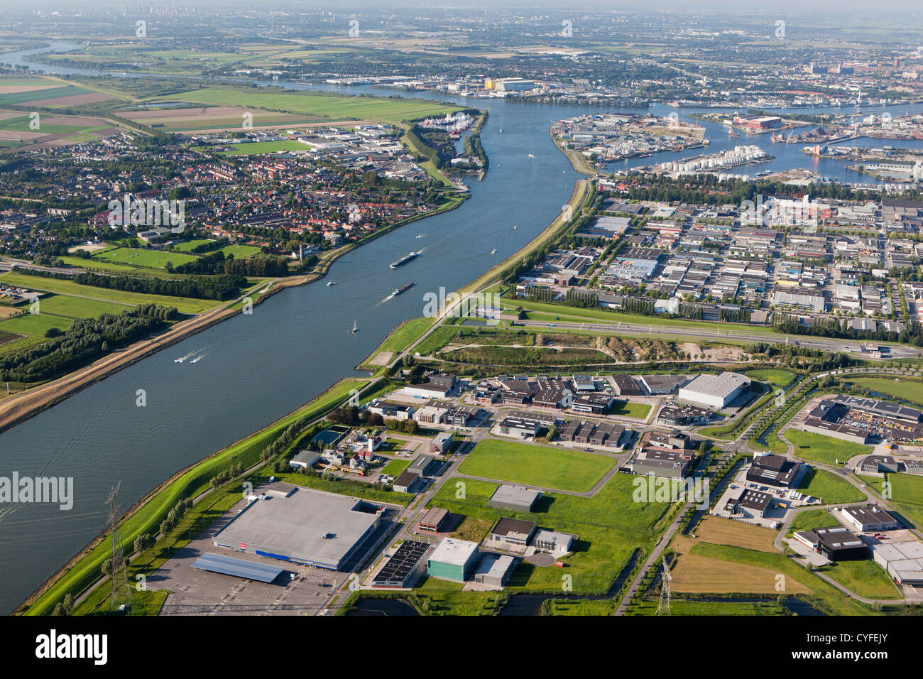 The Netherlands, Dordrecht, boats in river called Dordtse Kil. Left the village of 's-Gravendeel. Right industrial - Stock Image