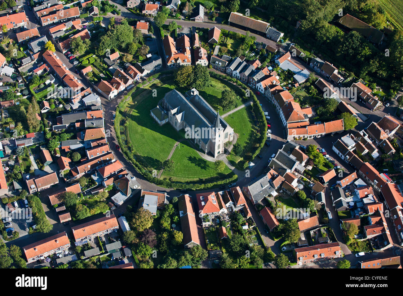 The Netherlands, Dreischor, View on the circular village center and church. Aerial. - Stock Image