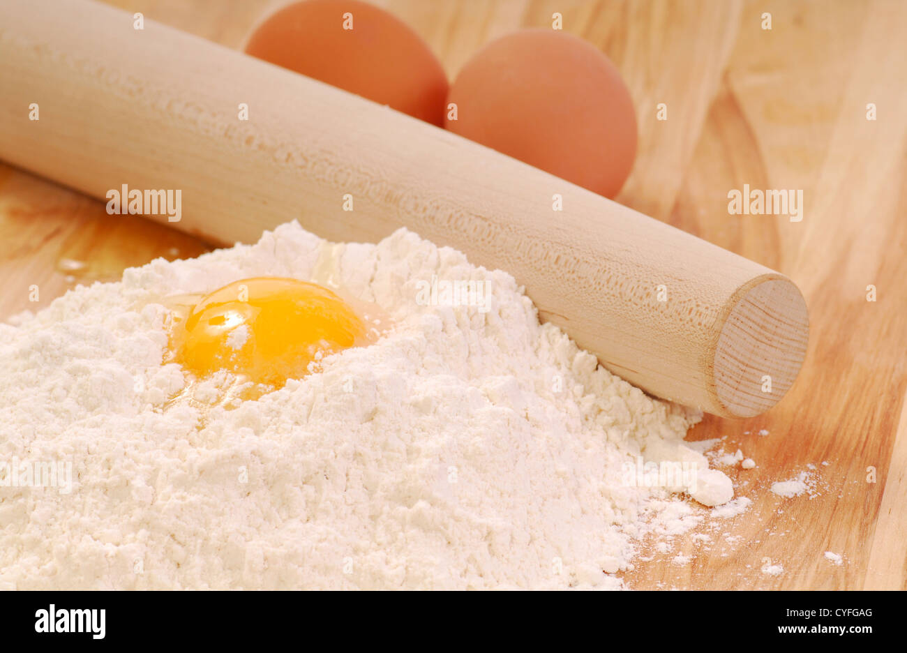 Ingredients for making fresh pasta being prepared on a cutting board Stock Photo