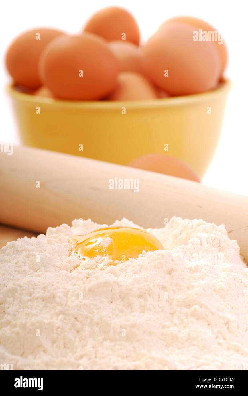 Mixing eggs and flour using the well method for making pasta Stock Photo