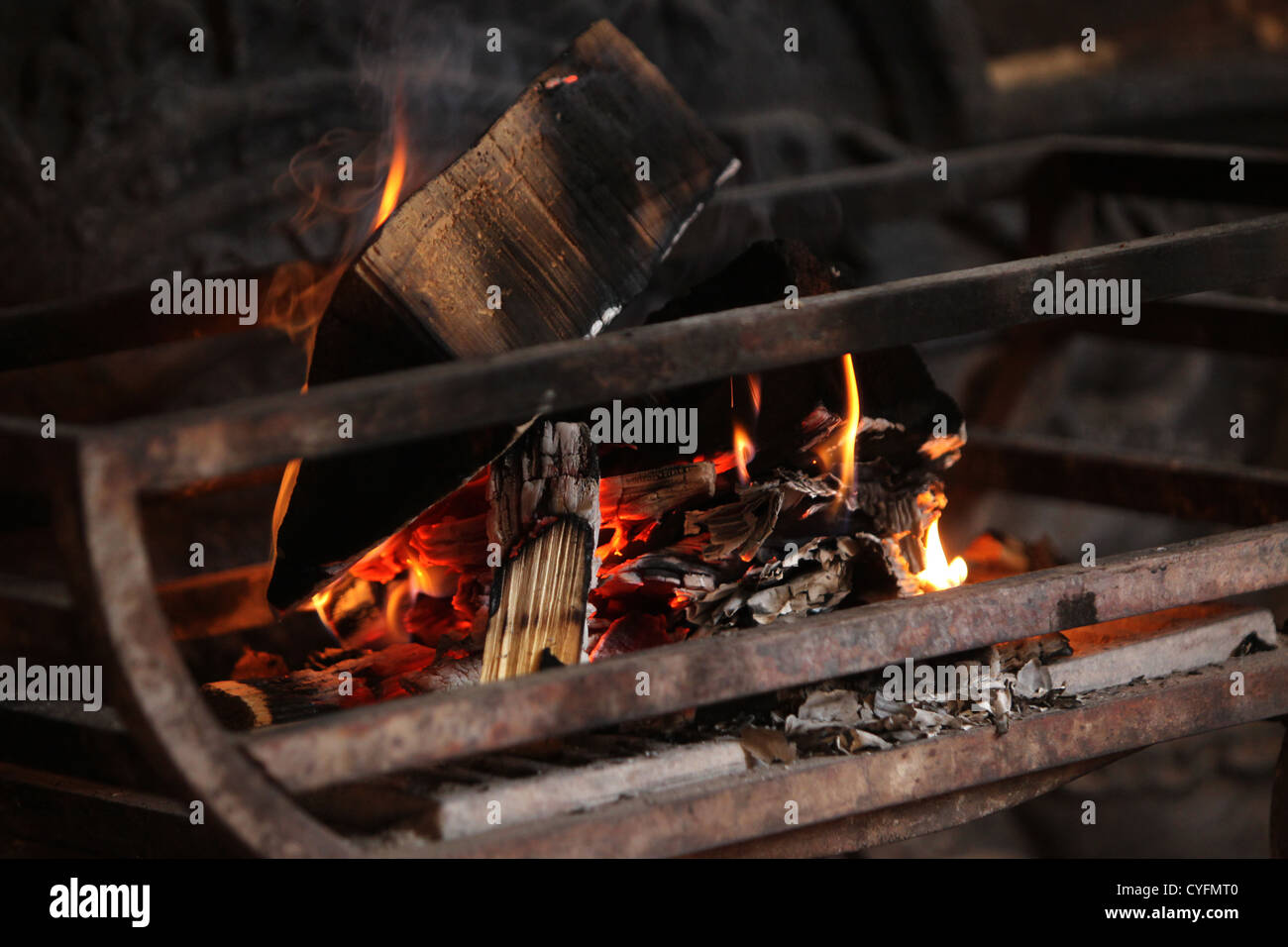 Fire burning at The Lamb pub in Angmering, Sussex, UK. - Stock Image