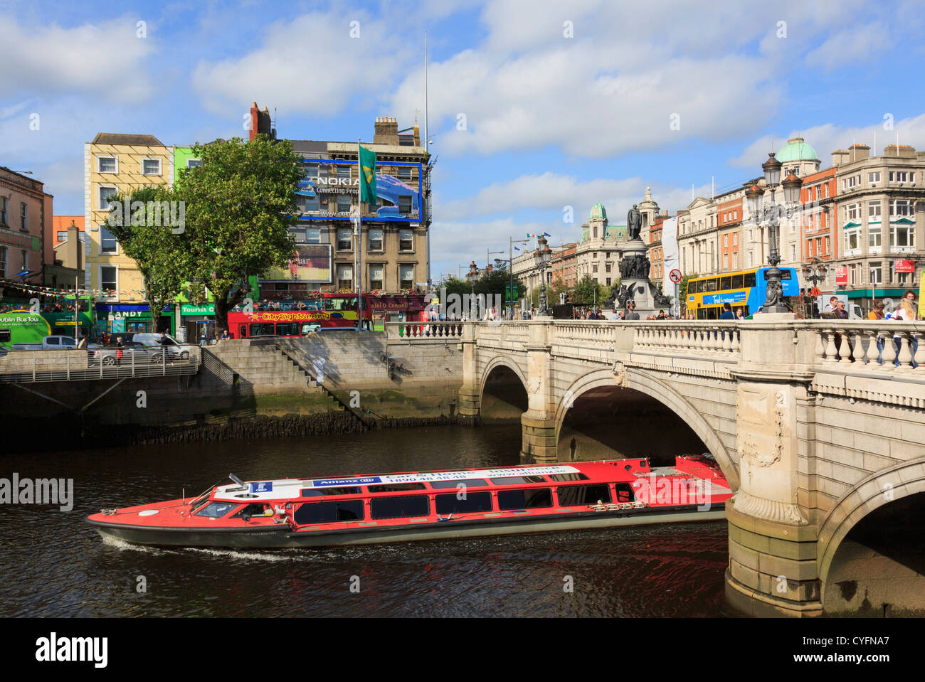 Sightseeing cruise boat passing under O'Connell Bridge on River Liffey in city centre Dublin, Republic of Ireland, - Stock Image