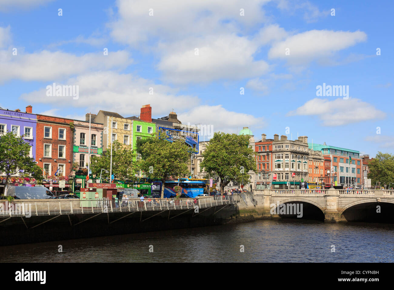 View across River Liffey to colourful riverside buildings on Batchelor's Walk by O'Connell Bridge in Dublin - Stock Image