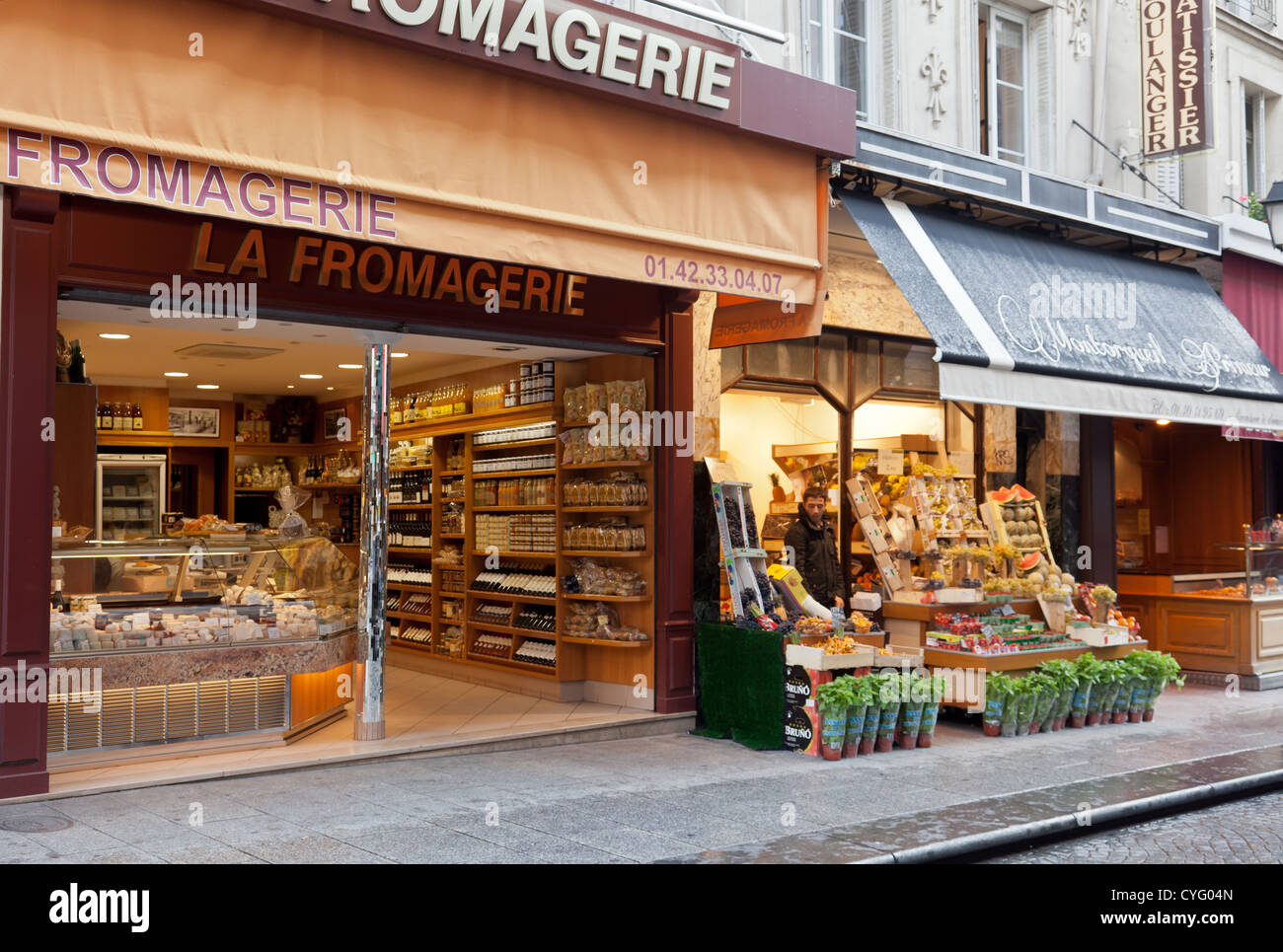 La Fromagerie, specialist cheese,wine and delicatessen shop and Montorgueil Primeur, fruiterer, Paris, France - Stock Image