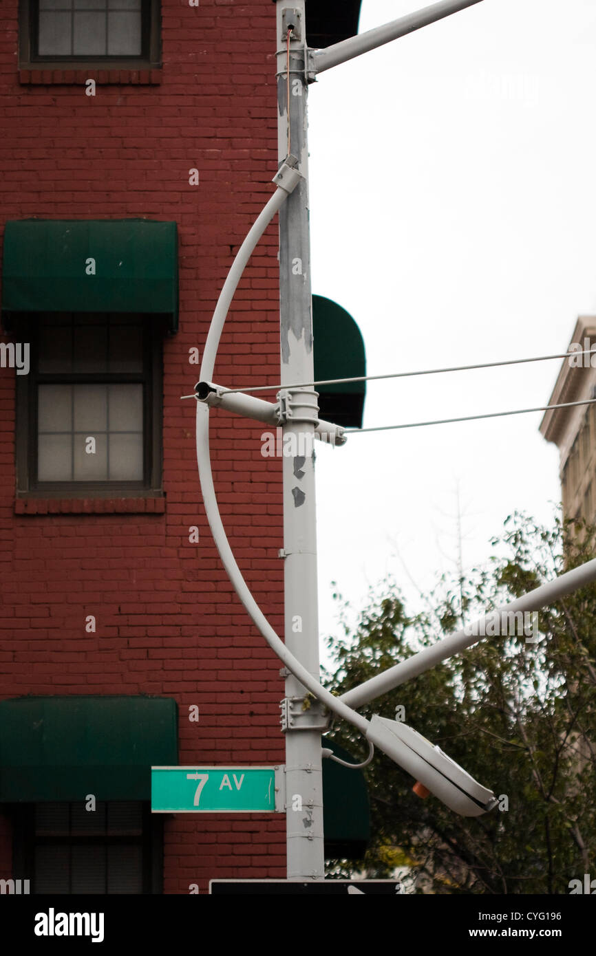 New York USA. Broken Streetlight dangling from wires coming out of a pole on 7th Avenue in New York City caused - Stock Image