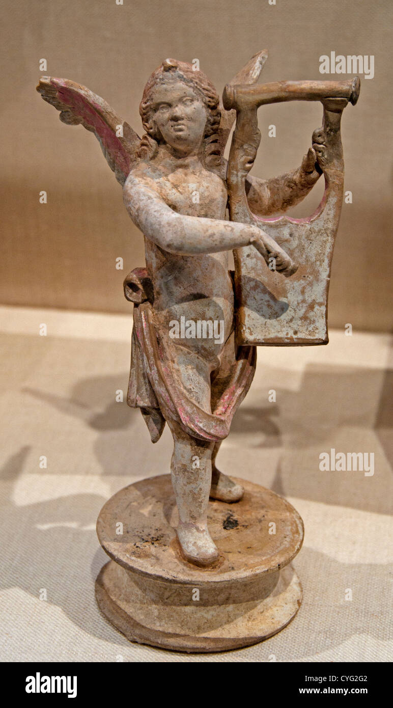 Terracotta statuette of Eros playing a lyre Hellenistic 3rd–2nd century B.C. Greek 17 cm Greece - Stock Image