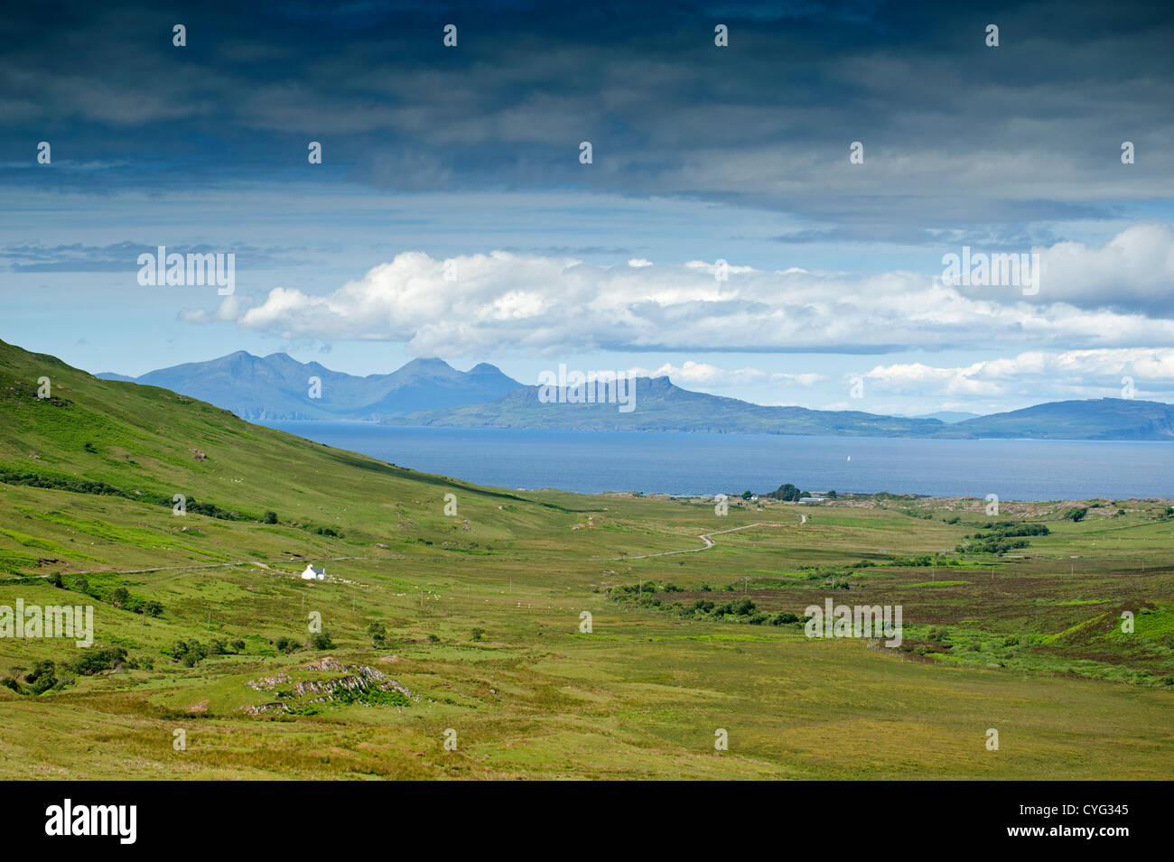 Looking West to the Islands of Eigg and Rhum from Kilmory on the Ardnamurchan Peninsula Scotland.  SCO 8768. Stock Photo