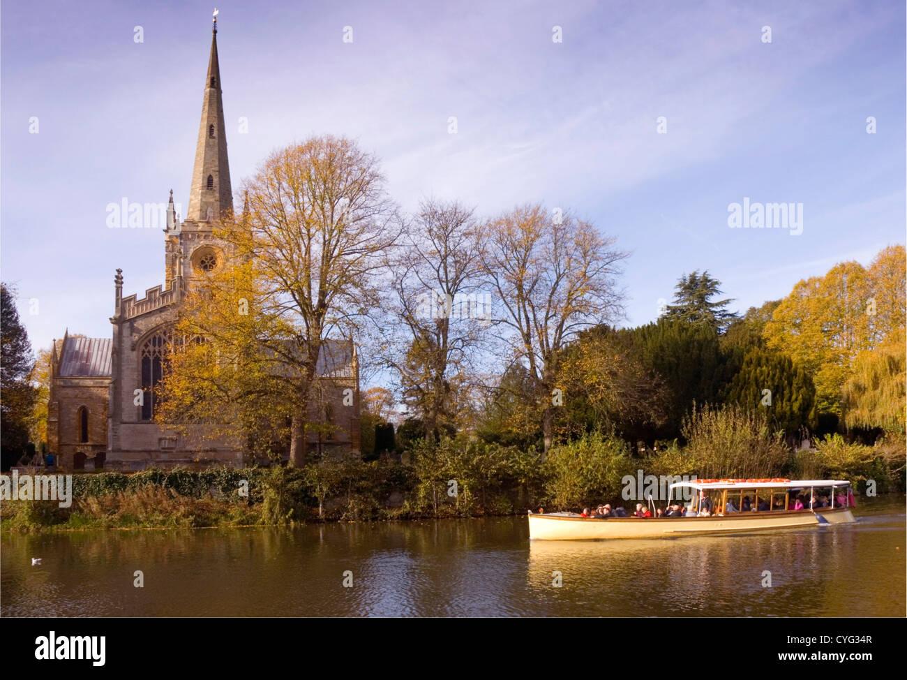 Warwickshire - Stratford upon Avon - river scene - tourist river cruise - passing Holy Trinity - autumn sunlight - Stock Image
