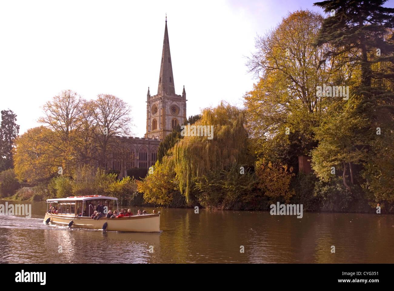 Warwickshire Stratford upon Avon - river scene - tourist river cruise - backdrop Holy Trinity church - autumn colours - Stock Image