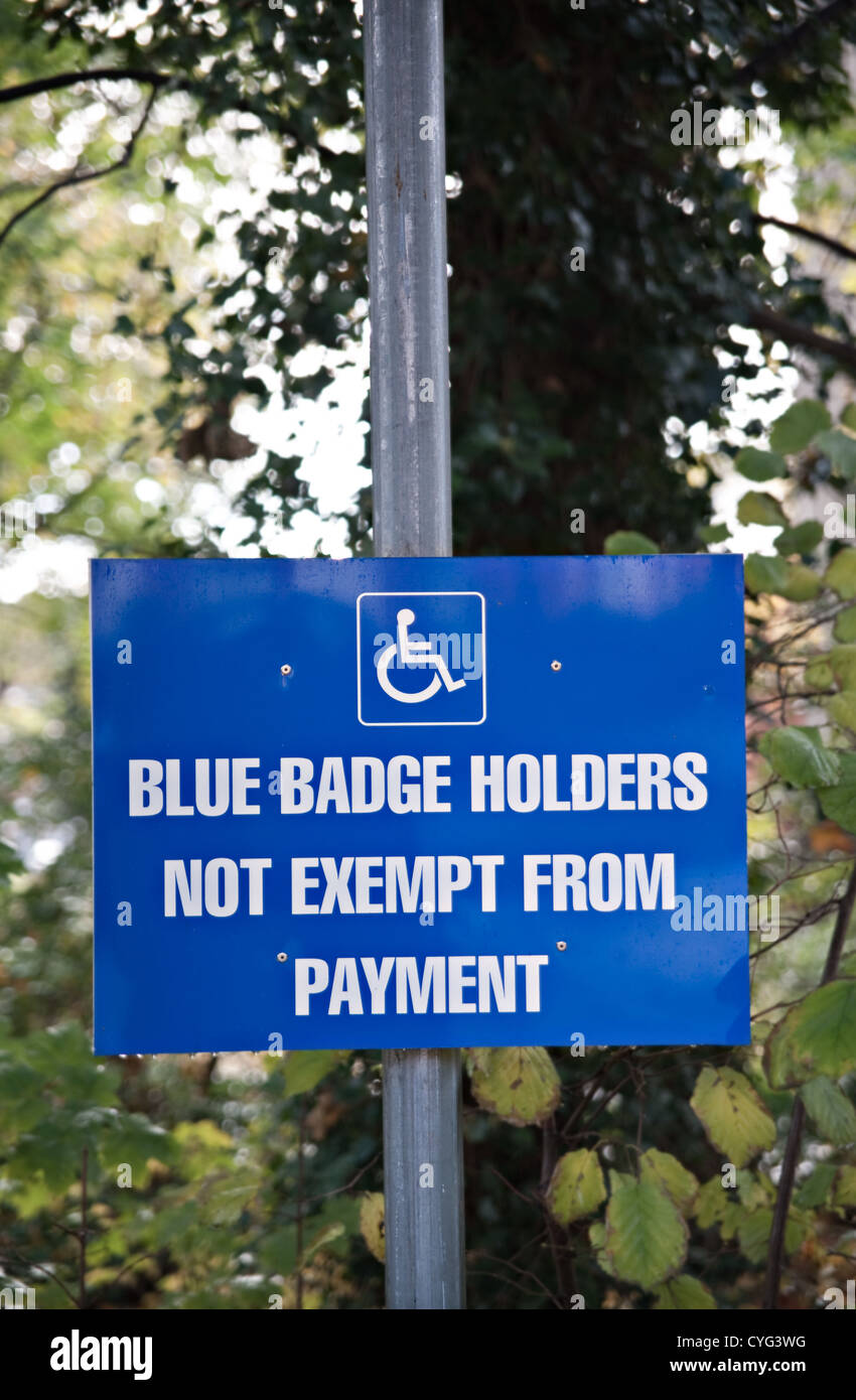 A 'Blue Badge Holder Not Exempt From Payment'  sign, UK - Stock Image