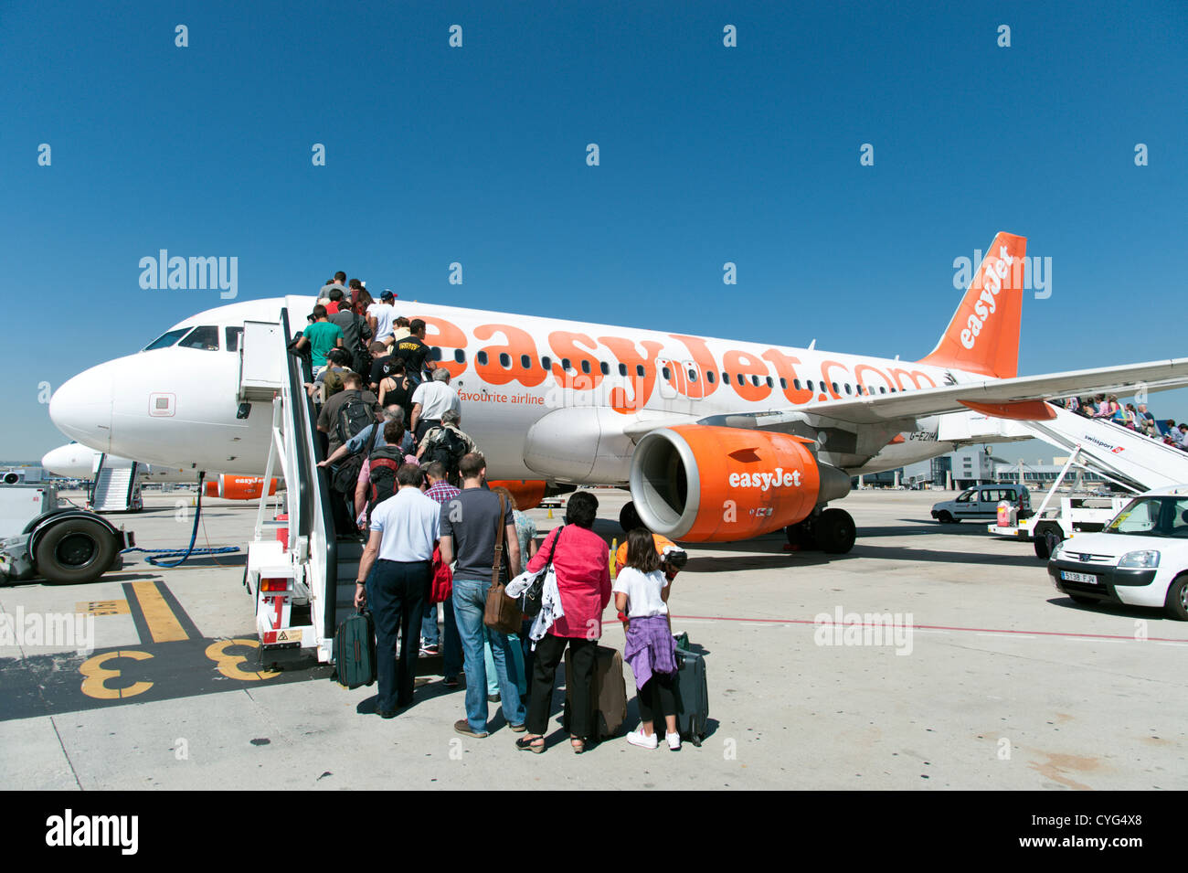 Passengers boarding Easyjet plane, Spain - Stock Image