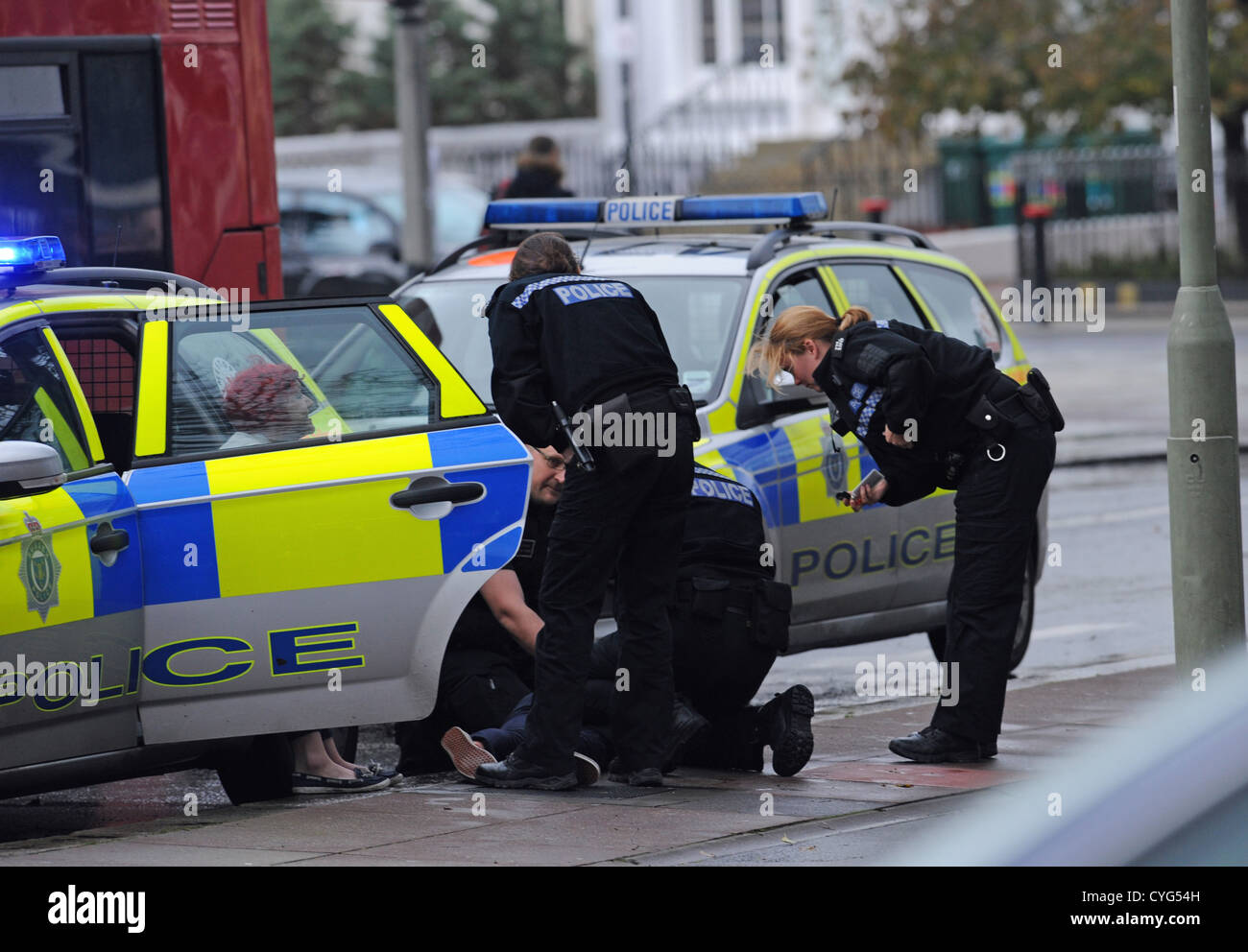 Brighton Sussex UK 4 November 2012 - Police make an arrest outside the Sainsbury's Local store in St James's - Stock Image
