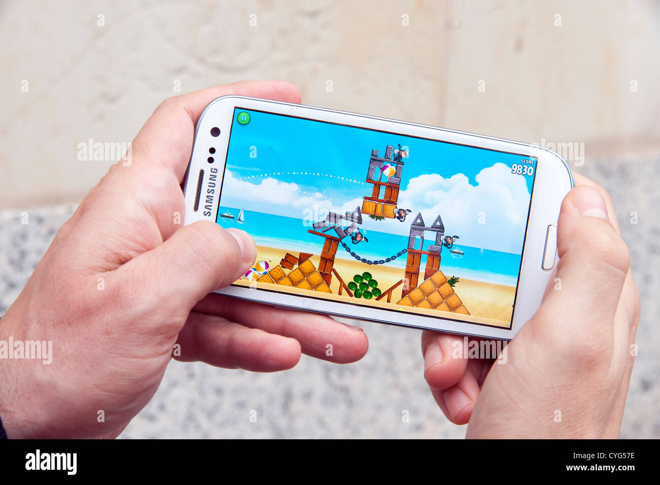 Playing Angry Birds game on Samsung Galaxy S3 smartphone - Stock Image