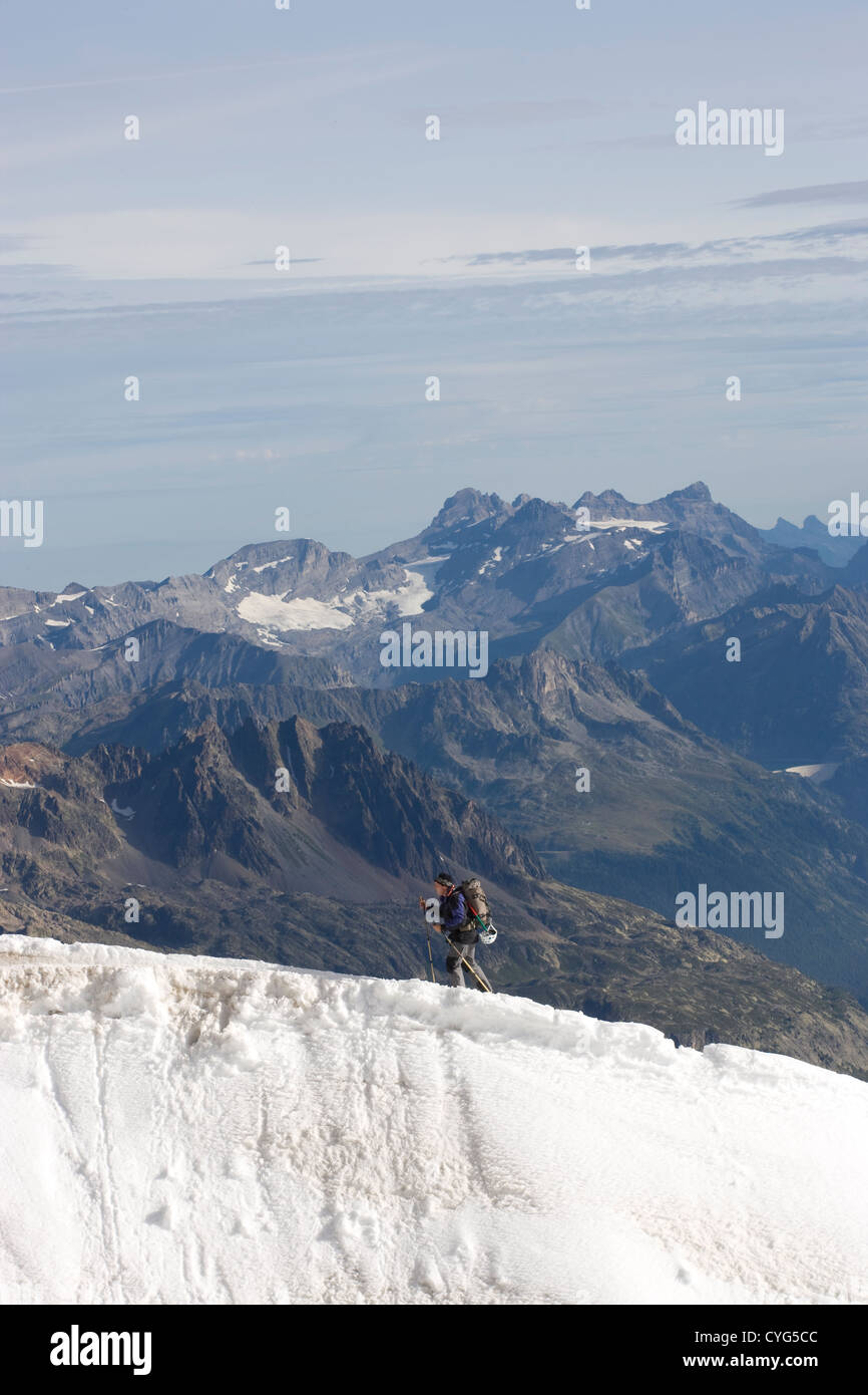 Courmayeur - Mont Blanc / hiker approaching the Aiguille du Midi. France in the background. - Stock Image