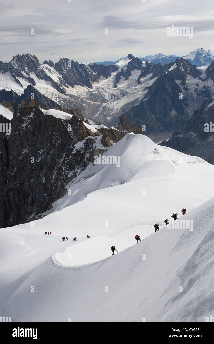Courmayeur - Mont Blanc / Aiguille du Midi / climbers setting out from the summit. - Stock Image