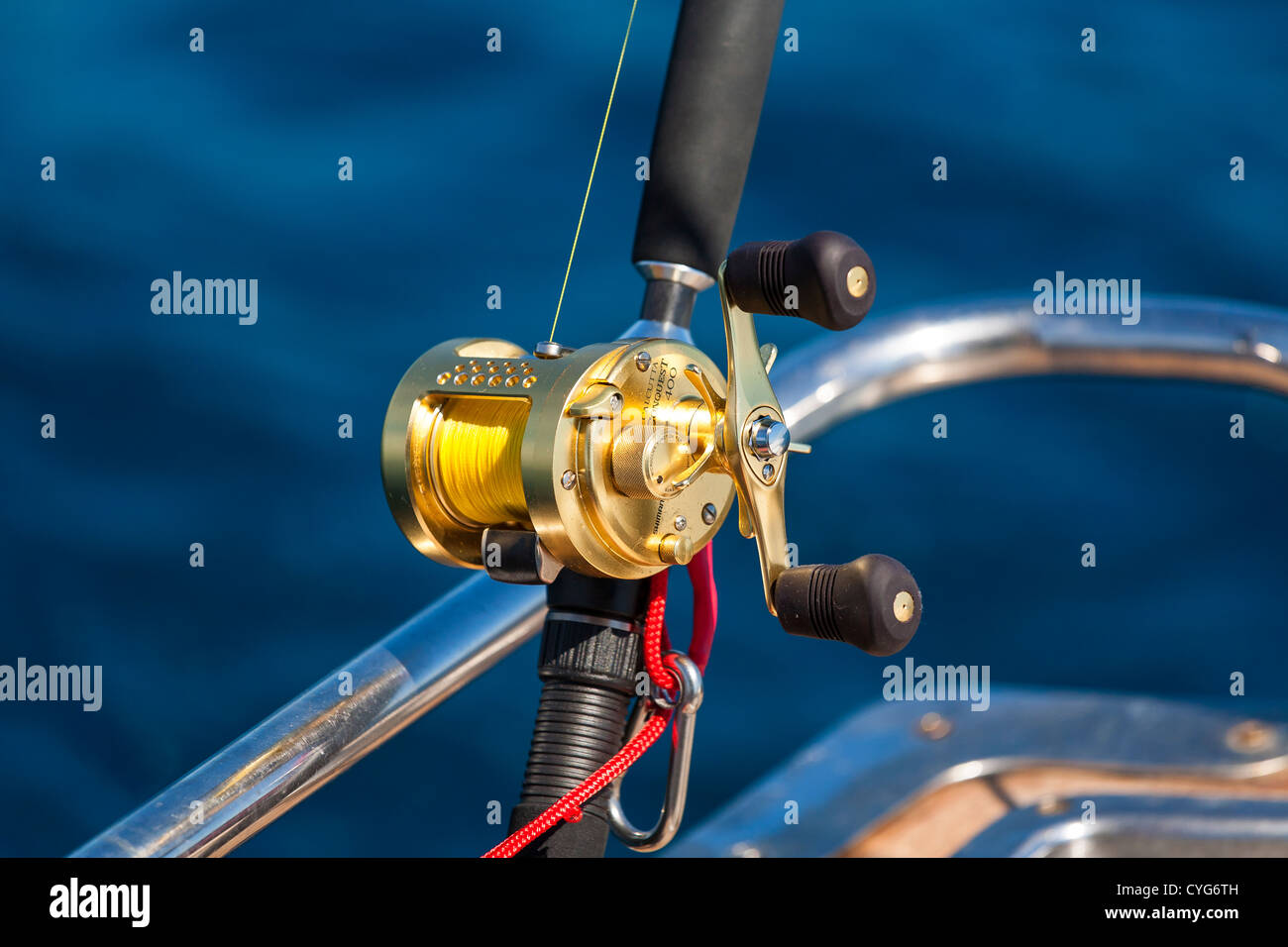 Shimano Conquest trolling reel with safety lanyard attached. - Stock Image