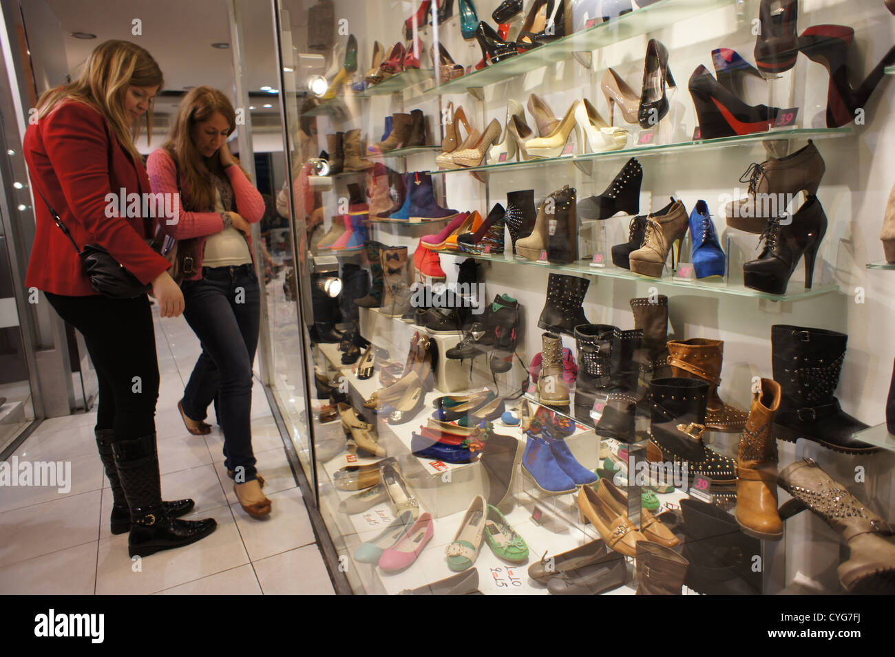 c50d70503d6 Women looking at shoes in shop window Stock Photo: 51373606 - Alamy