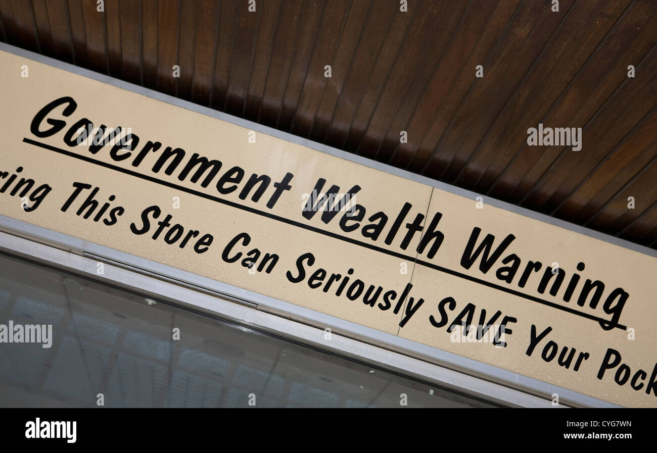 Government Wealth Warning shop sign Wigan, Greater Manchester - Stock Image