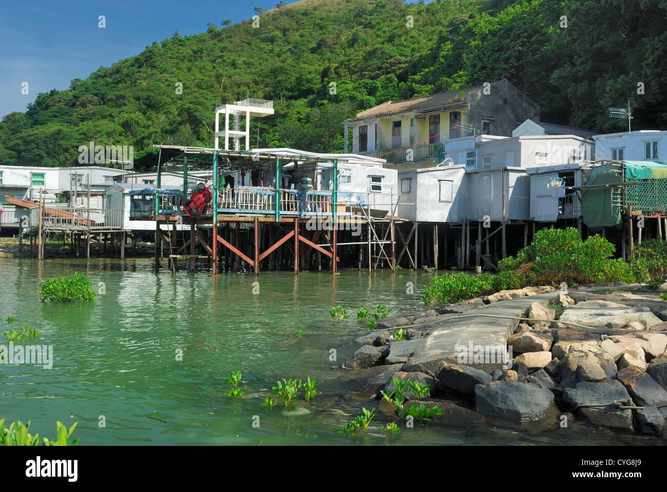Stilled houses line the shore of Tai O fishing village on Lantau Island Hong Kong China. - Stock Image