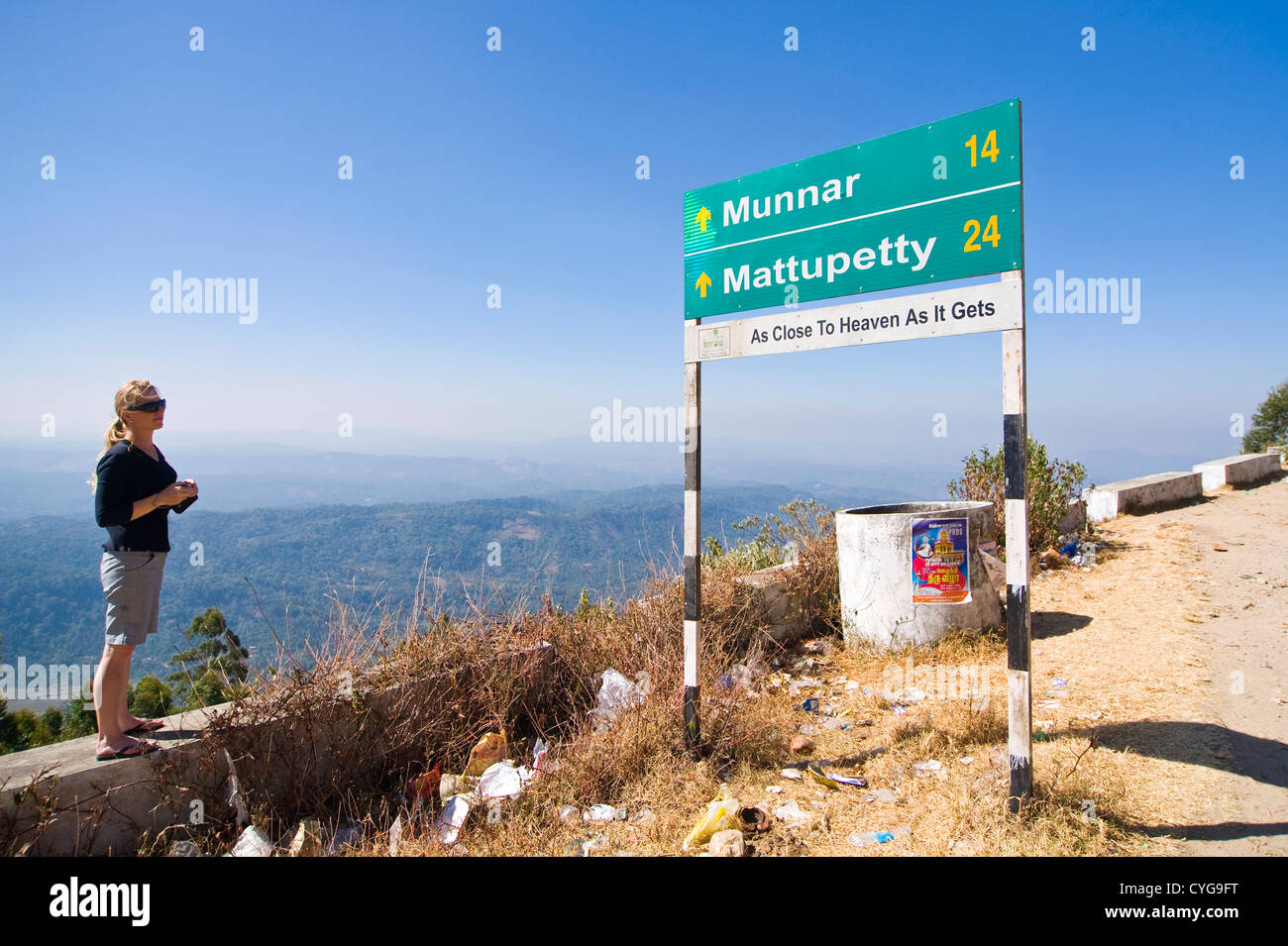 Horizontal view of a Western tourist taking in the stunning landscape in high ranges of Kerala. Stock Photo