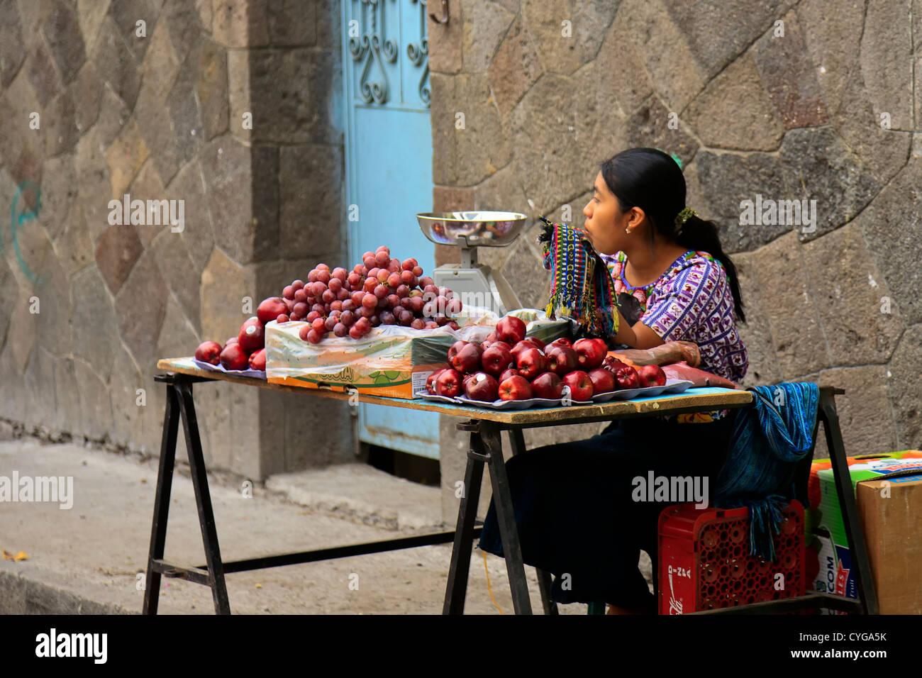 Woman selling fruit in Santiago Atitlan, Lake Atitlan, Guatemala - Stock Image