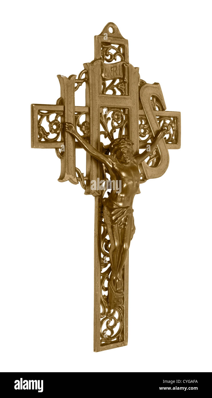 A brass cross representing a crucifix which is a Catholic symbol of their savior on a cross - path included - Stock Image