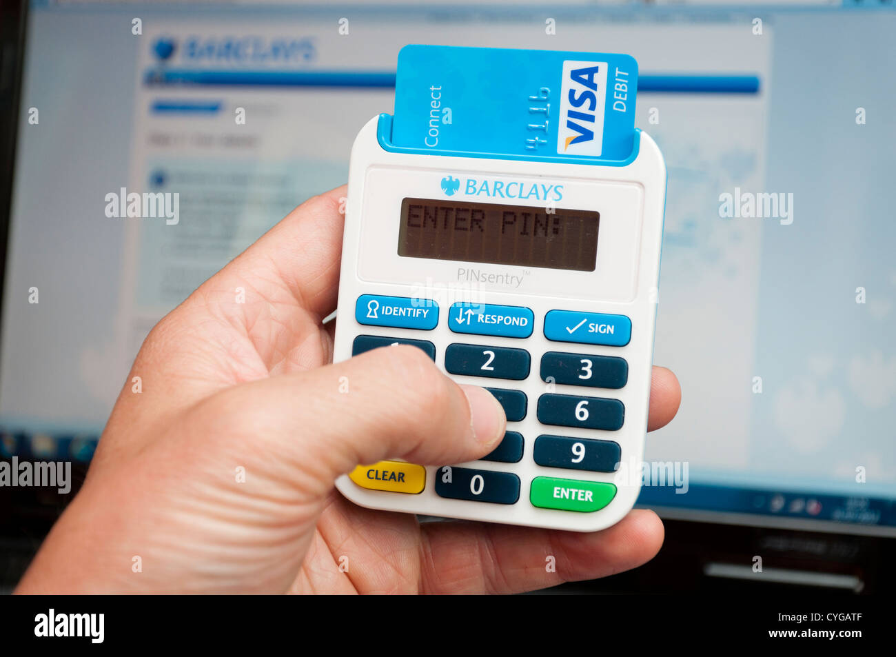 Online banking PINsentry security chip and pin card reader for authorising transactions through Barclays Bank account. - Stock Image