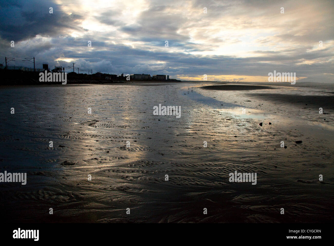 Sunset Reflections with Beautiful Colours on Howth Beach, Co Dublin, Ireland - Stock Image