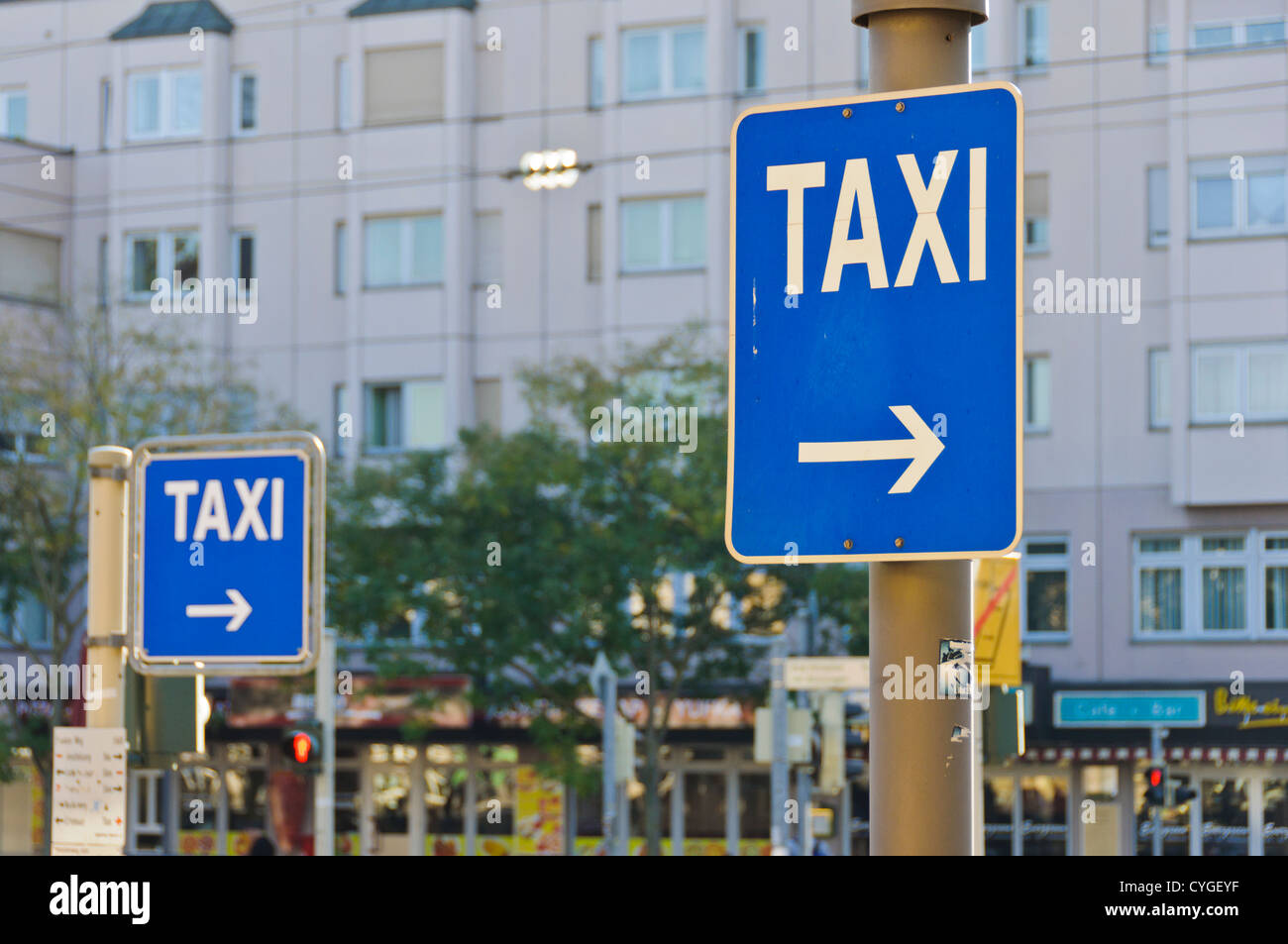 Two TAXI signs - Stock Image