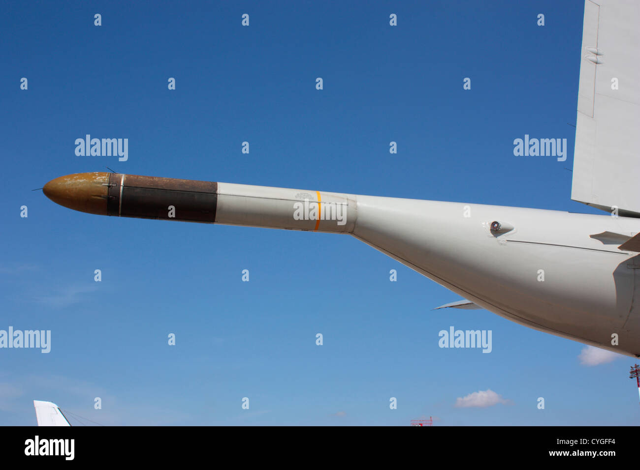 The magnetic anomaly detector boom, which is used to detect submarines, on the tail of a US Navy P-3 Orion - Stock Image