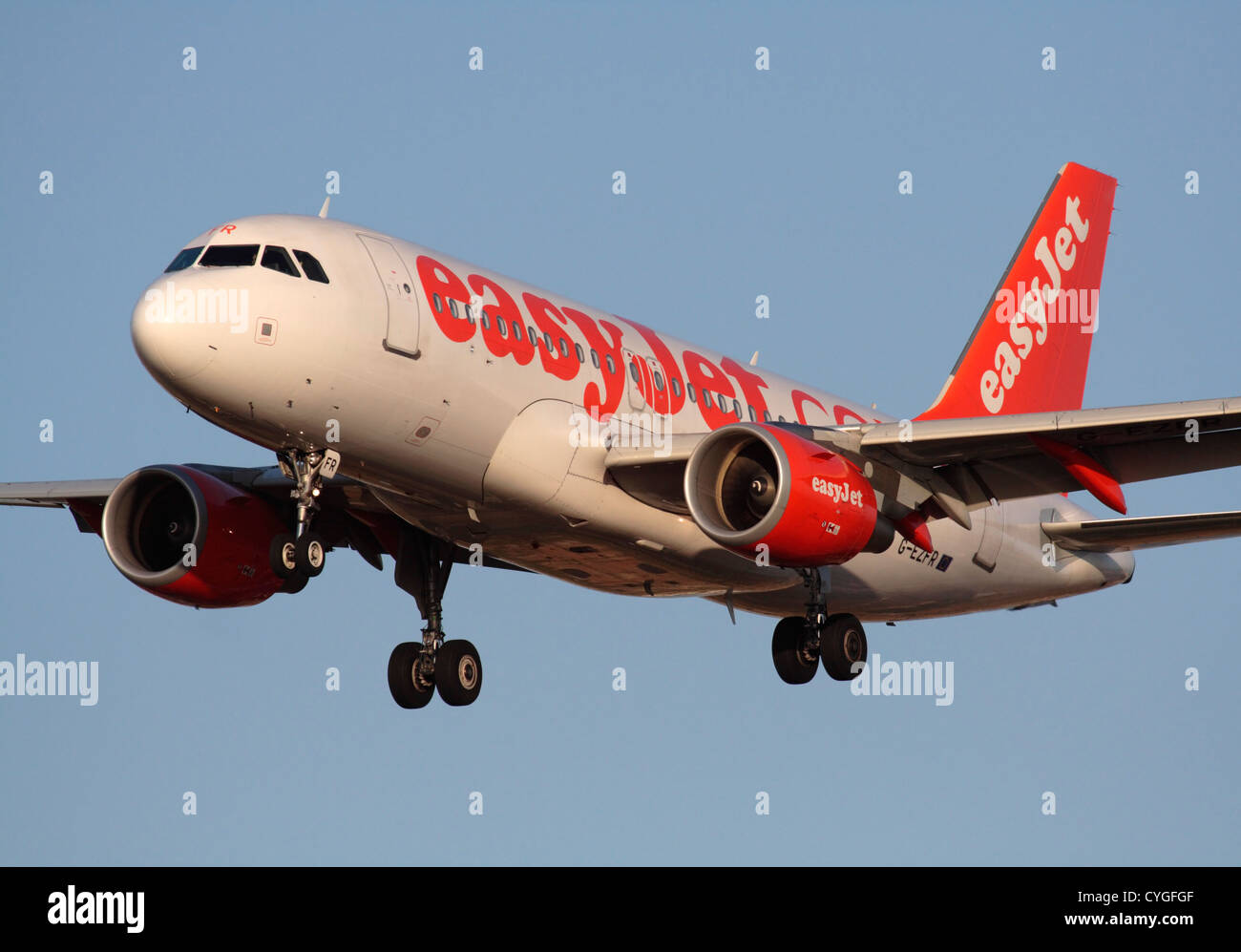 Low cost air travel. Airbus A319 passenger jet plane belonging to budget airline easyJet on approach against a clear - Stock Image