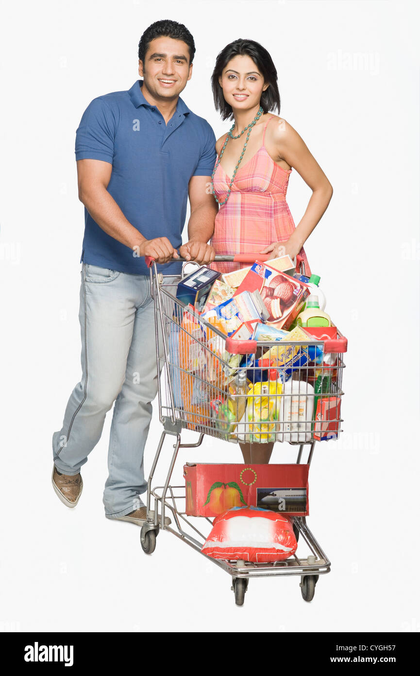 Couple with shopping cart - Stock Image