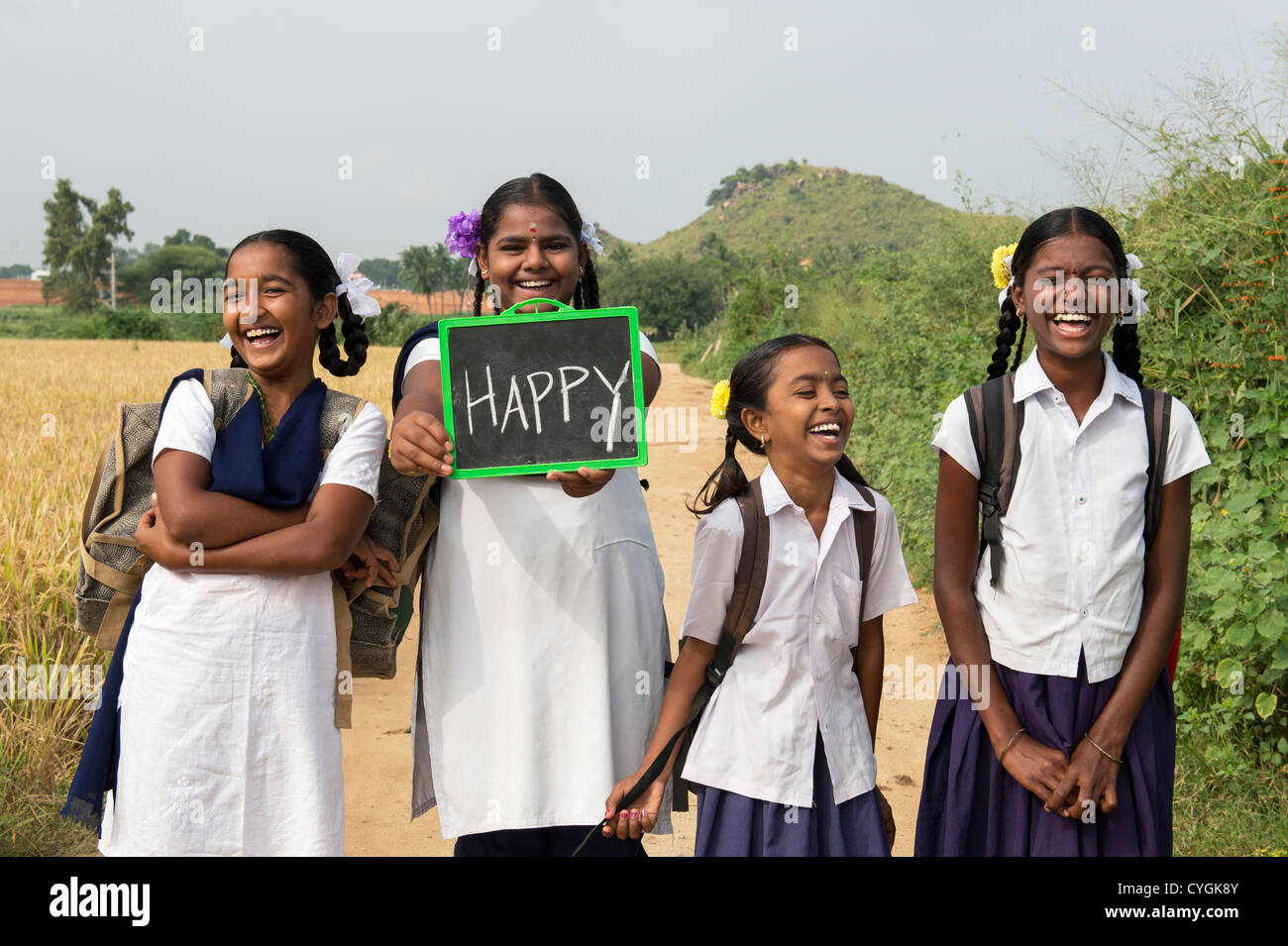 Laughing Indian School Girls Holding A Chalkboard With Happy Written On It Andhra Pradesh