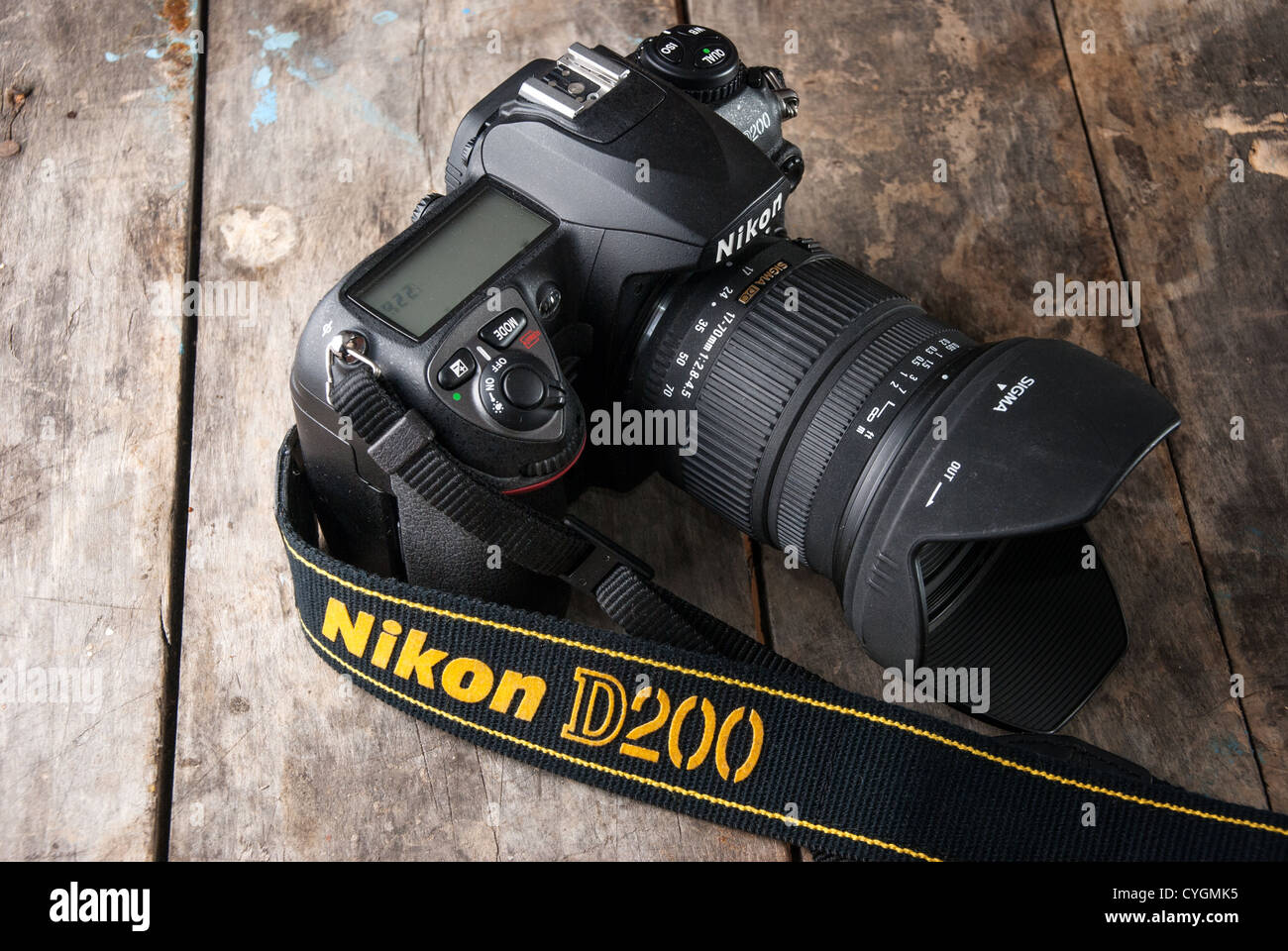 -Nikon D200 digital SLR with Sigma 17-70 DC lens on old wooden table. Manufactured by Nikon and Sigma Corporation. - Stock Image