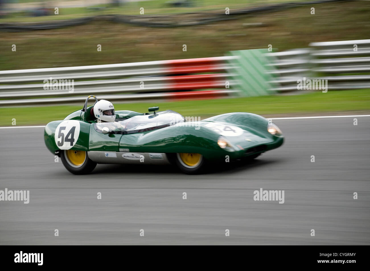 A Lotus 11 classic racing car driving fast on a racing track Stock ...