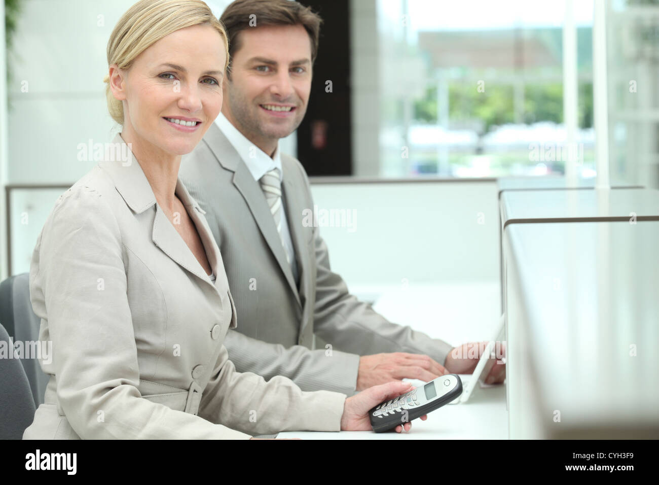 Smiling receptionists - Stock Image