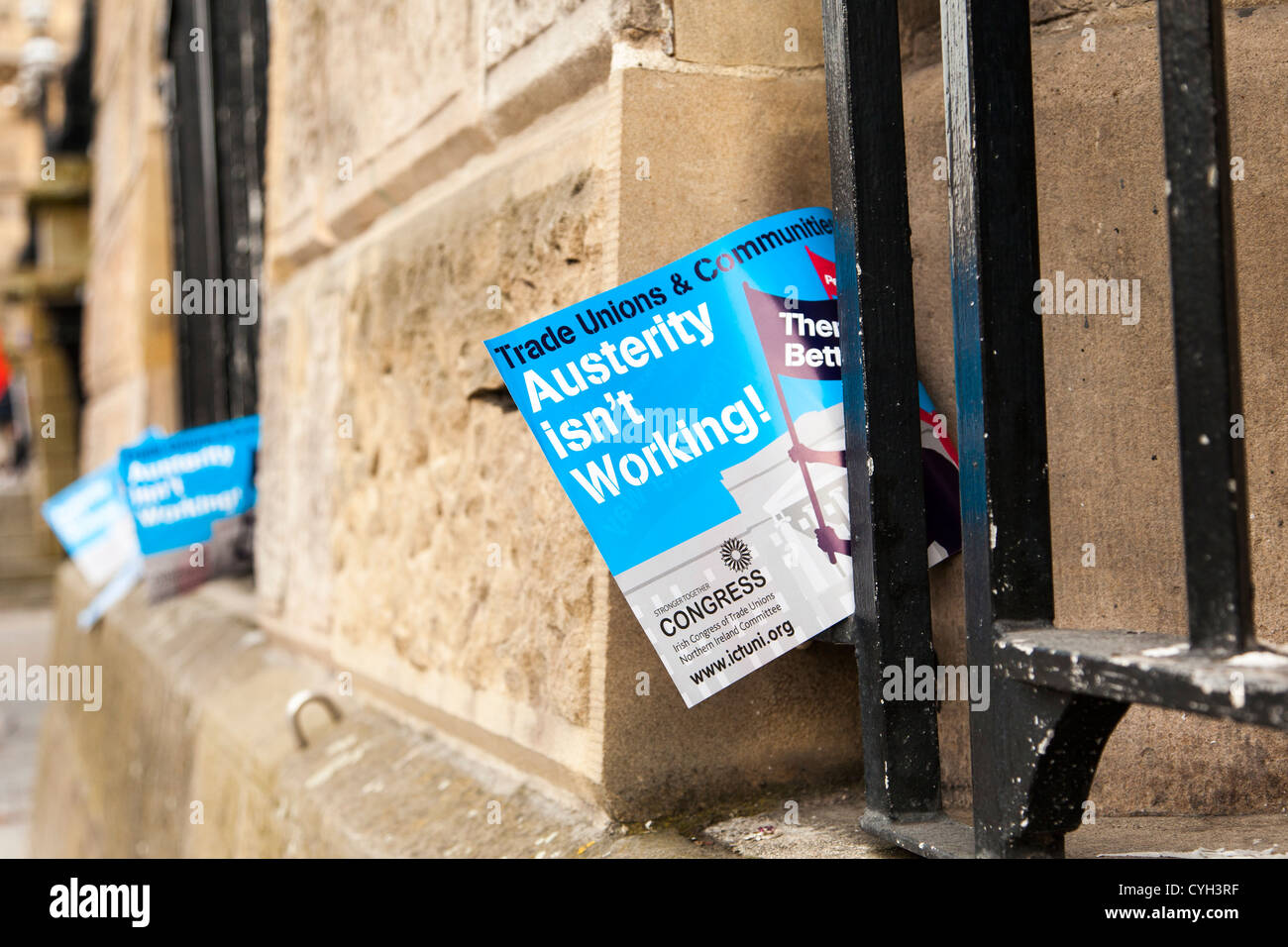 Austerity isn't working flag in grill at window of Custom House, Belfast, Northern Ireland - Stock Image
