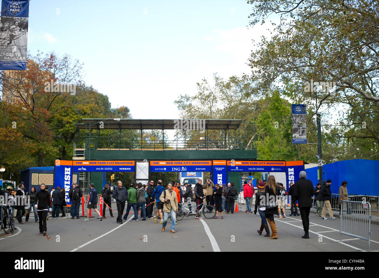 People congregate in Central Park at the finish line for the 43rd Annual ING New York City Marathon - Stock Photo