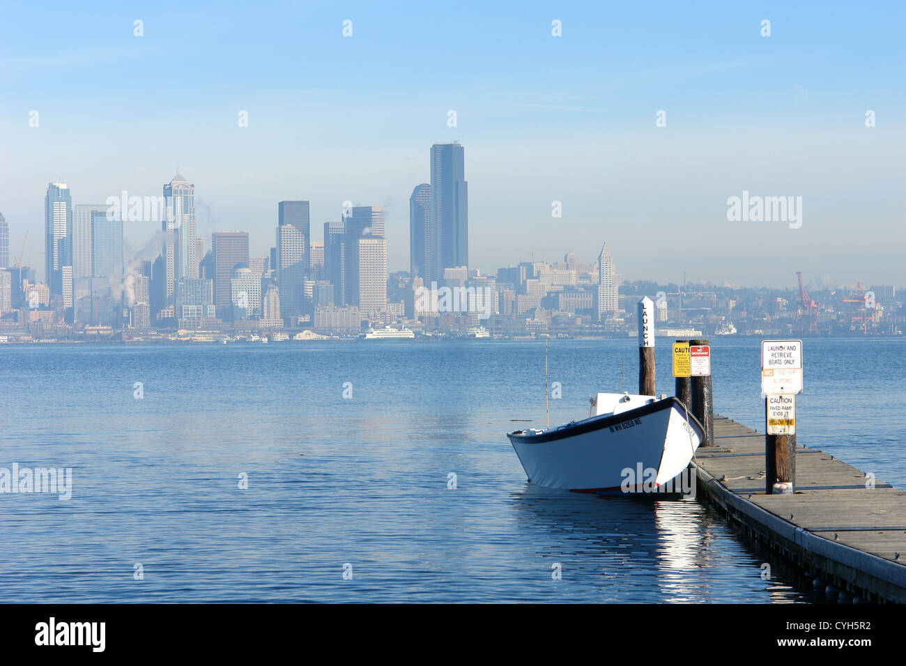 Row Boat with the city of Seattle in the background - Stock Image
