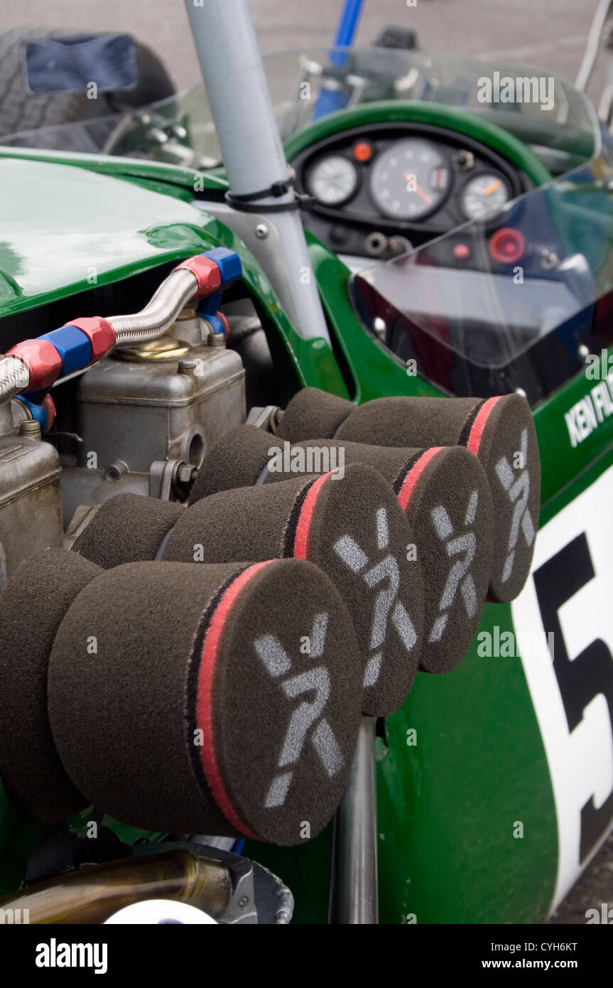 Air filters on the engine of a classic racing car. - Stock Image