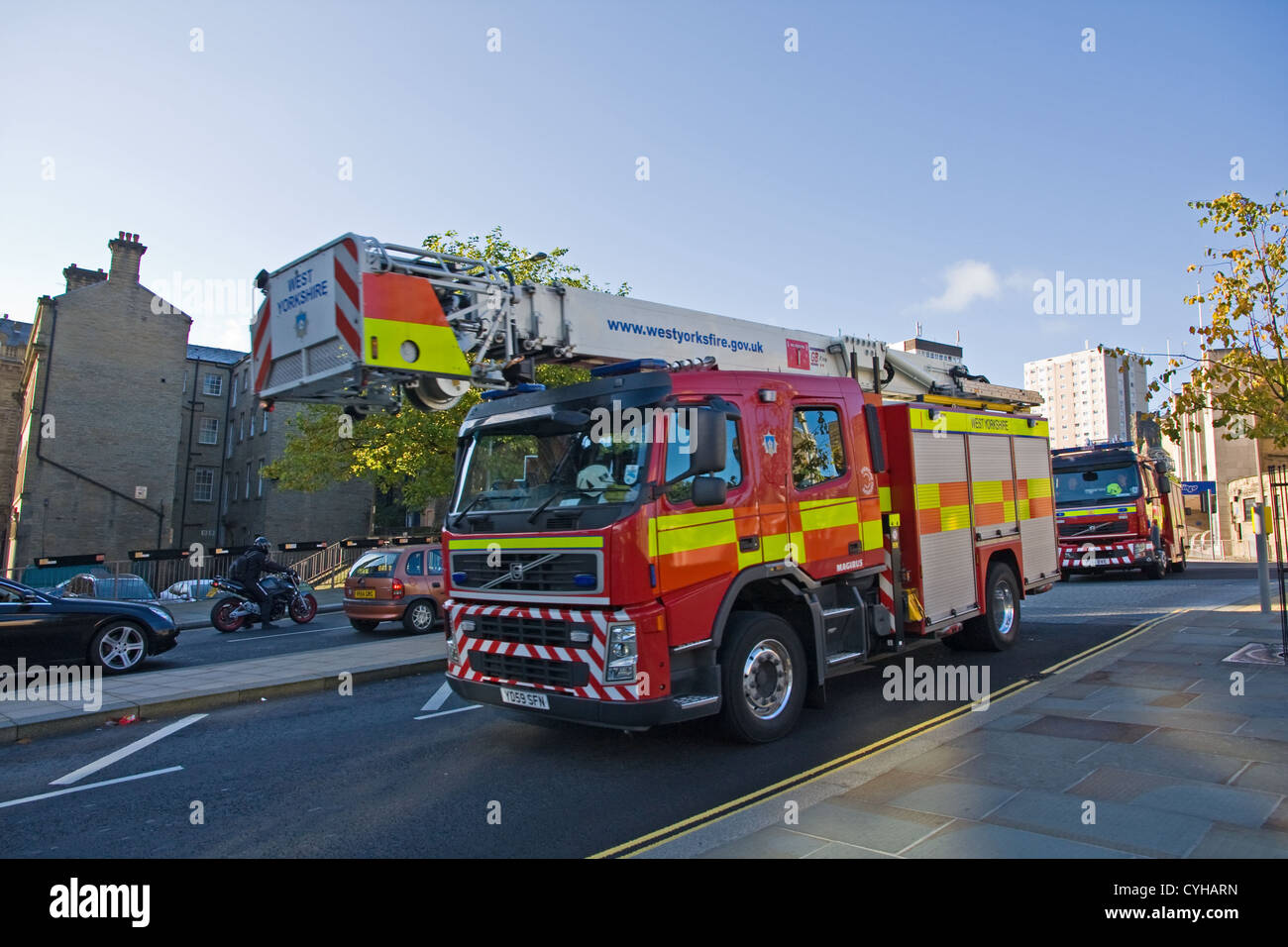 Fire Service elevating platform being followed by fire engine - Stock Image