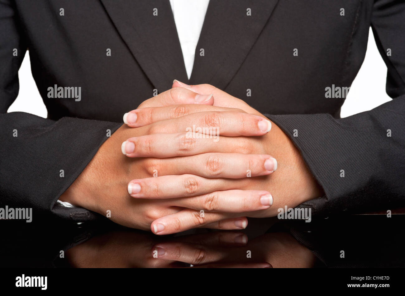 Business woman waiting with fingers crossed - Stock Image