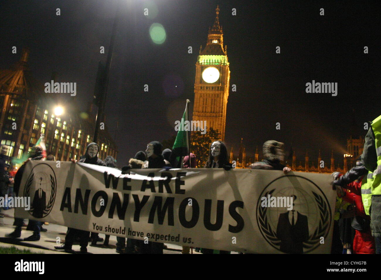 London, UK. 5th November 2012. Anonymous UK protesters gather outside Parliament in London to demonstrate against - Stock Image