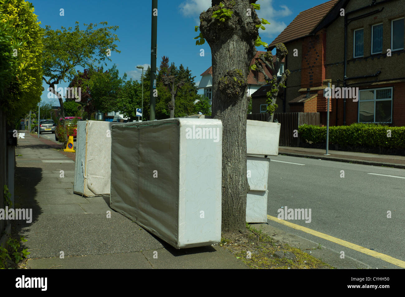 Fly tipping of mattresses and beds in street in Brent Cross Golders Green, London - Stock Image