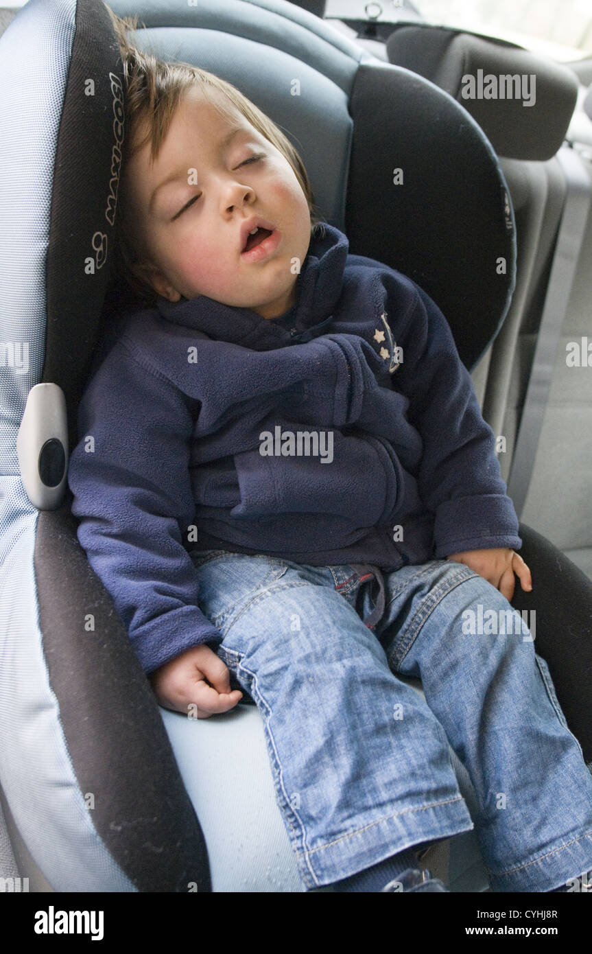 Two Year Old Child Sleeping In His Car Seat